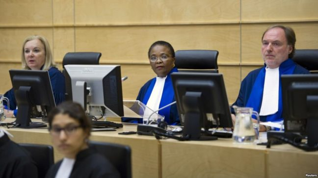 Gambian born ICC's Chief Prosecutor Tatou Bandoura listens to colleague