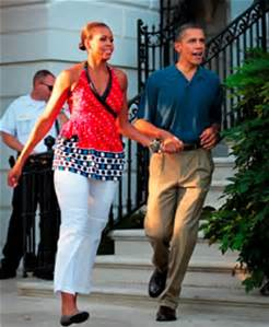 President and Mrs. Obama take quick move as the First lady relaxes in African fashion sports wear